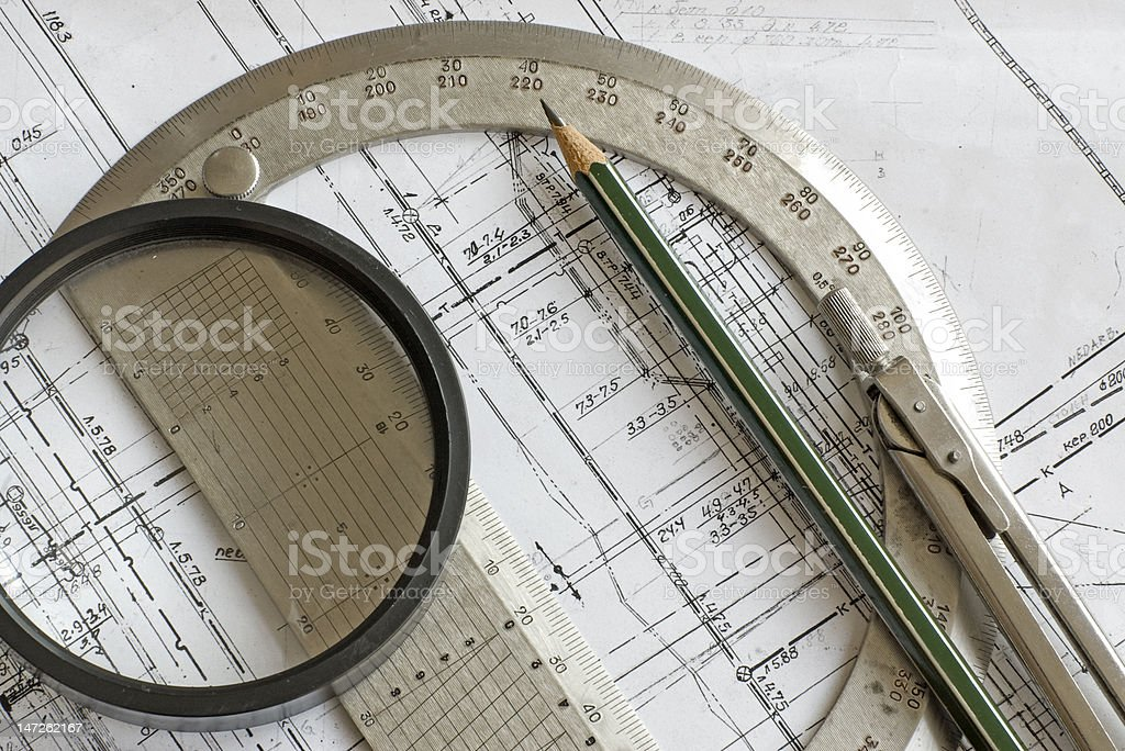 blueprint with pencil, steel protractor, compass and loupe royalty-free stock photo