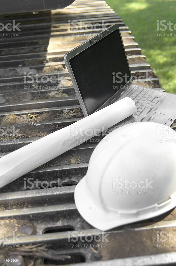 Blueprints and Computer on Excavator Track royalty-free stock photo