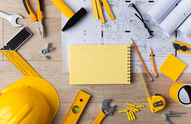 blueprints and construction tools - construction equipment stock photos and pictures