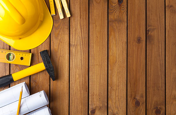 Blueprints and Construction tools Construction tools on a wooden background workbench stock pictures, royalty-free photos & images