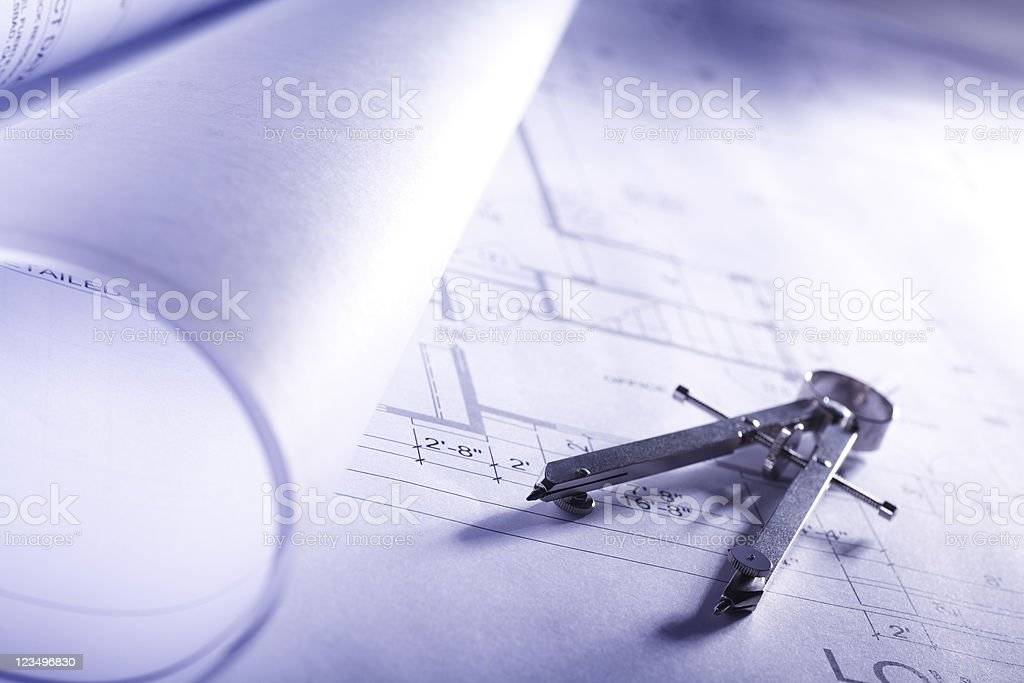 Blueprints and drawing compass royalty-free stock photo