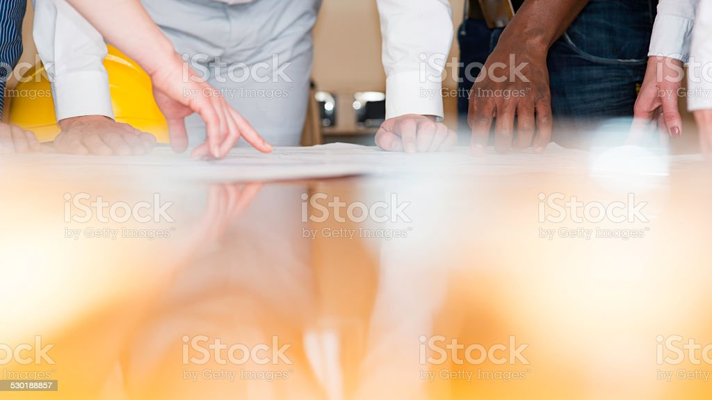 Blueprints and Hands stock photo