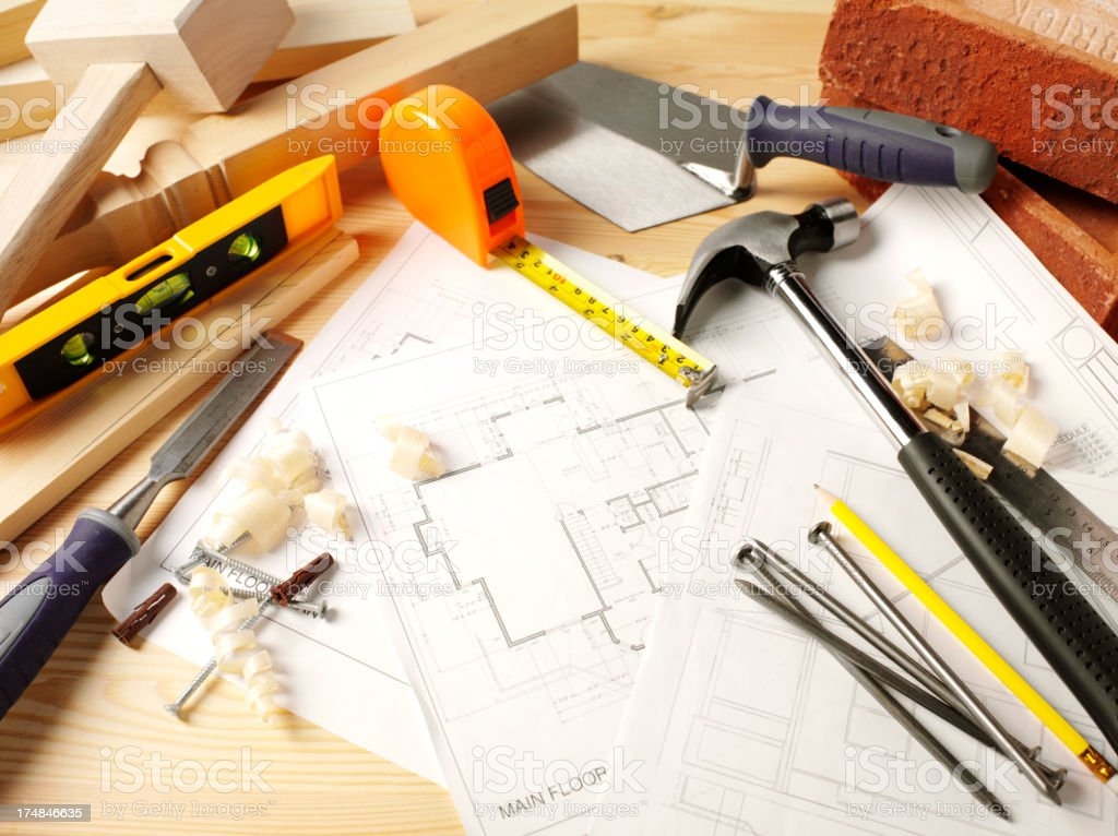 Blueprints on Wood with Work Tools royalty-free stock photo