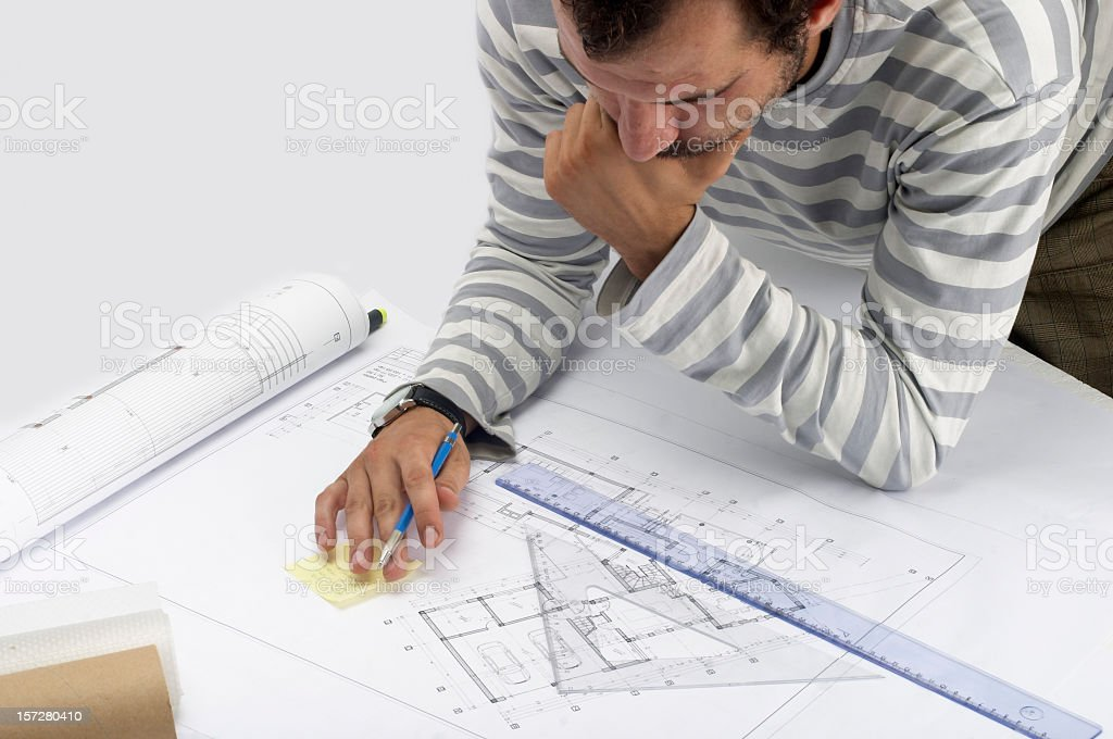 Blueprints with man drawing designs royalty-free stock photo