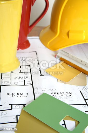 512113530 istock photo Blueprints with paint samples and hardhat 123693425