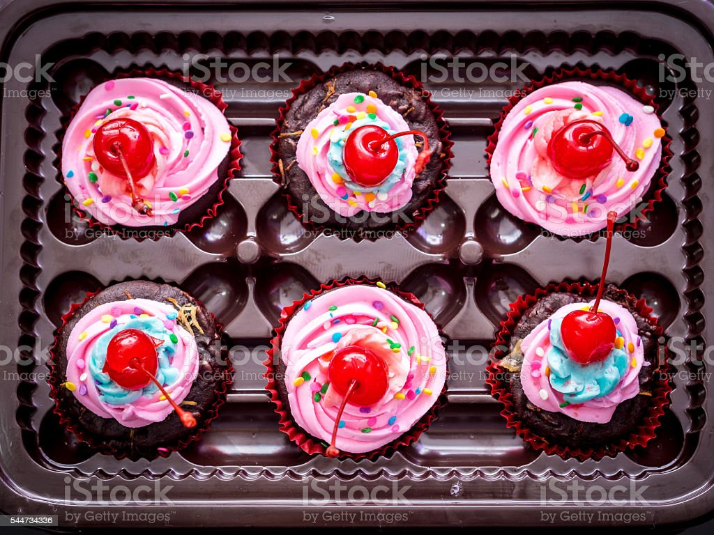 Blue-Purple Vegan Cupcakes with Cherry on Top foto royalty-free