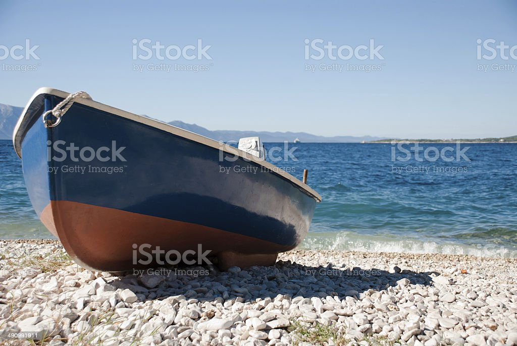 Blue-red boat on the beach stock photo