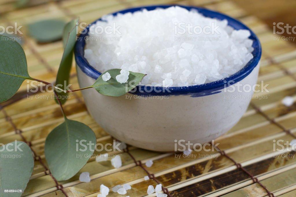 Blue-Rimmed Bowl Full of Coarse Sea Salt stock photo