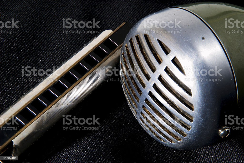 Blues harp and mic stock photo