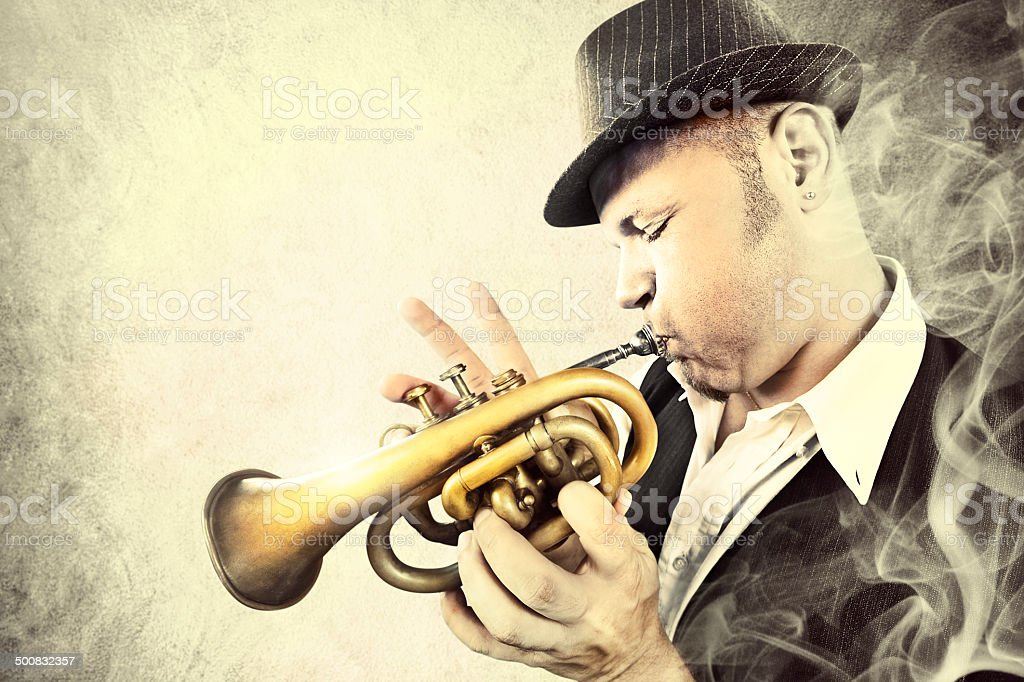Blues man performing with his trumpet in the night stock photo
