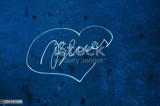 Blues writing inside a heart shape