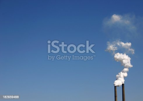 smokestacks against a clear sky