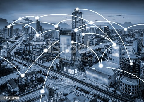 656082444 istock photo Bluetone cityscape and network connection 628617890