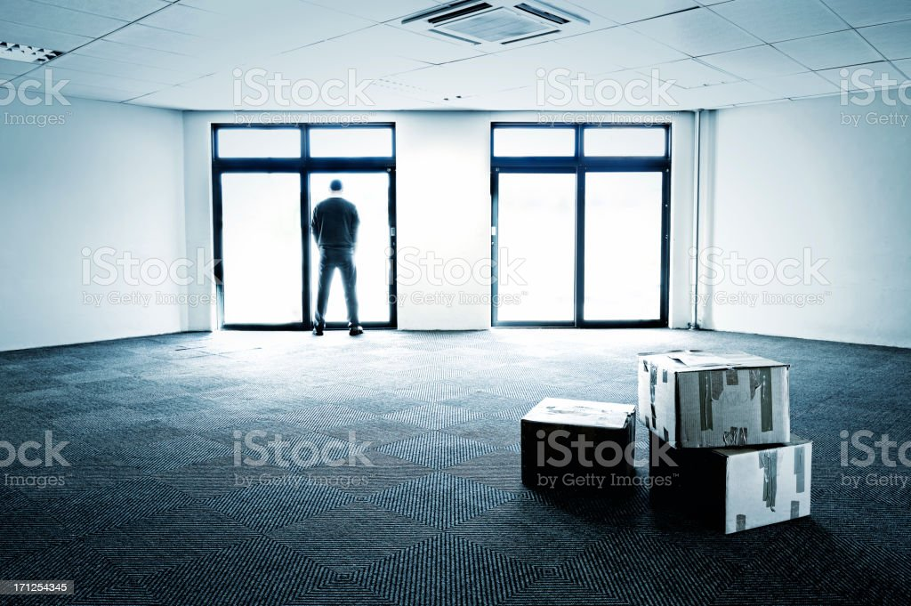 Blue-toned empty office showing business failure stock photo