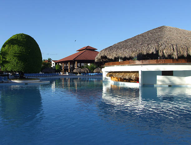 blue-water pool at a tropical resort - belkindesign stock pictures, royalty-free photos & images
