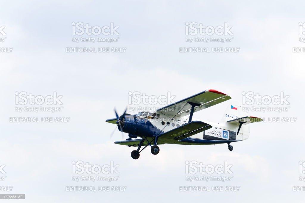 Blue-white Antonov An-2 flying stock photo