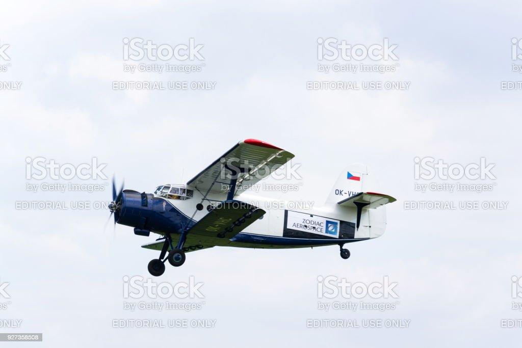 Blue-white Antonov An-2 flying - Royalty-free Adult Stock Photo