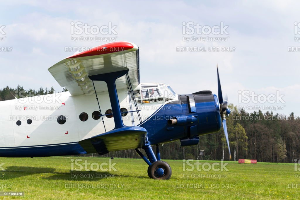 Blue-white Antonov An-2 preparing for takeoff on airfield on April 30, 2017 in Plasy, Czech Republic. stock photo