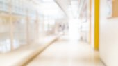 istock Blur abstract background of corridor in clean hospital. Blurred view of aisle in office with light floor. Blurry lobby and waiting area in hotel. Defocused empty area for event hall in shopping mall 1171217617