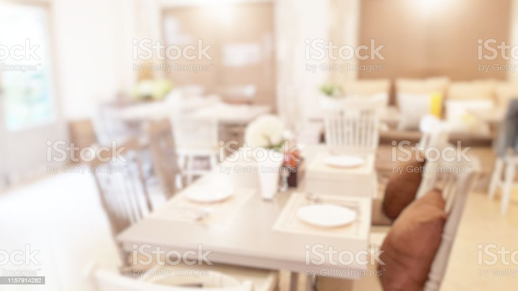 Blur abstract background of modern clean cafeteria room with chairs...