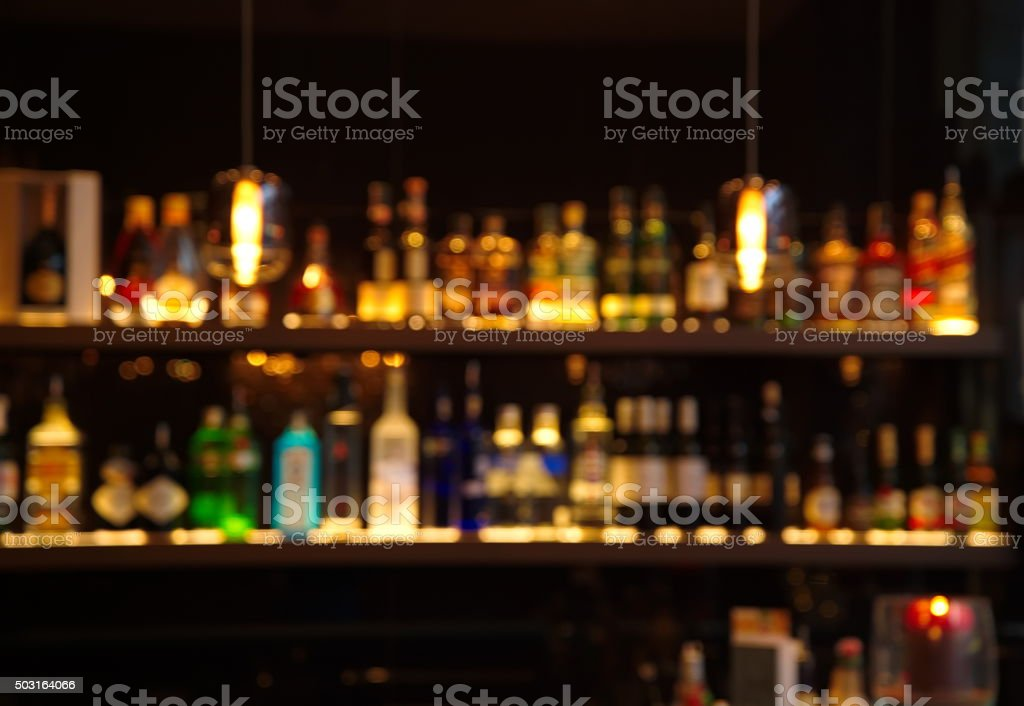 blur alcohol drink bottle at pub in dark night stock photo