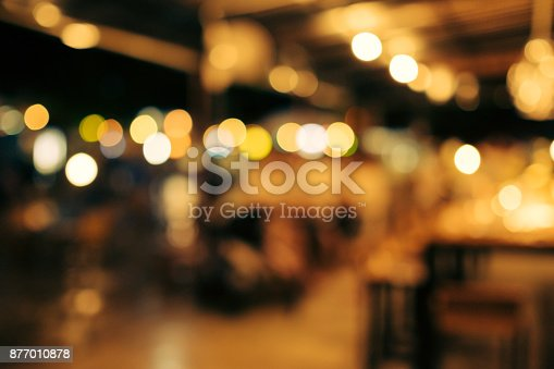 blur and bokeh of night party in a restaurant. The night light in a party when people is enjoying and laughing.