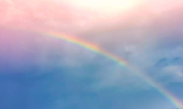 Blur and haze blue and pink pastel sky  with rainbow over the cloud stock photo