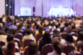 istock Blur  audience sitting in hall or auditorium  or classroom 544683950