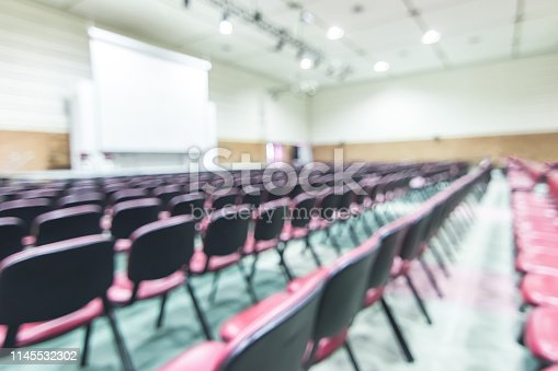 istock Blur auditorium concert hall or seminar meeting room in educational business event 1145532302