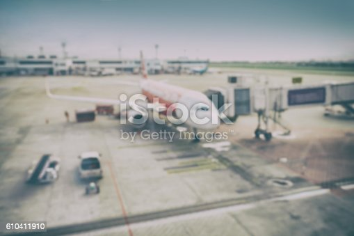 istock Blur background aircraft and loading unloading area, airport 610411910