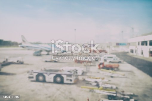istock Blur background aircraft and loading unloading area, airport 610411940