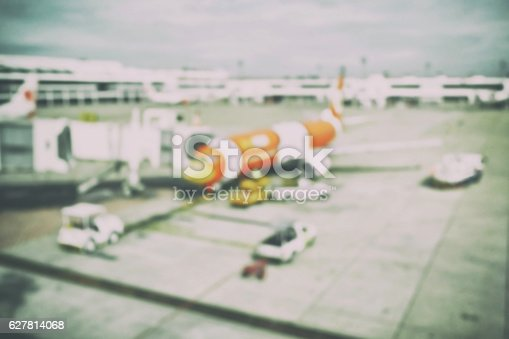 istock Blur background aircraft and loading unloading area, airport 627814068
