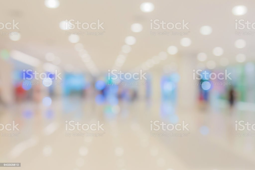 blur background image of shopping mall or department store with bokeh and people background usage concept stock photo