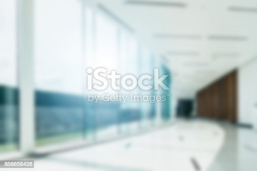 istock Blur background inside office hallway interior with glass wall window 856656438