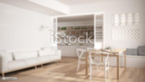istock Blur background interior design, minimalist kitchen and living room with sofa, table and chairs 697211124