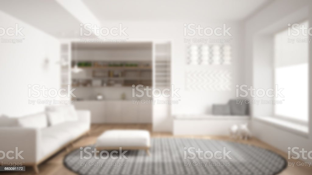 Blur background interior design, minimalist living room with sofa, big round carpet and kitchen in the background stock photo
