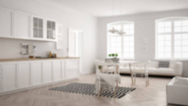 Blur background interior design, minimalist modern kitchen with dining table and living room stock photo