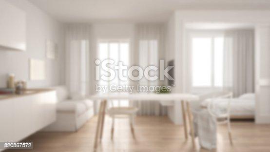 istock Blur background interior design, scandinavian kitchen with sofa and table, wooden parquet floor 820867572