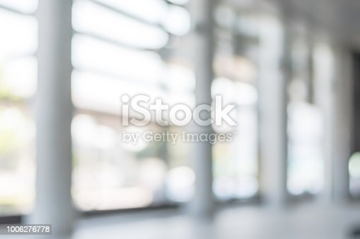 1009742300 istock photo Blur background interior view looking out toward to empty office lobby and entrance doors and glass curtain wall 1006276778