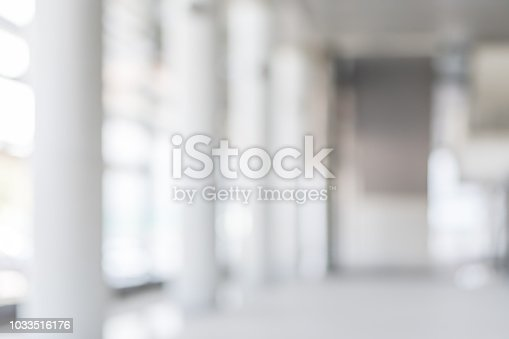 istock Blur background interior view looking out toward to empty office lobby and entrance doors and glass curtain wall 1033516176