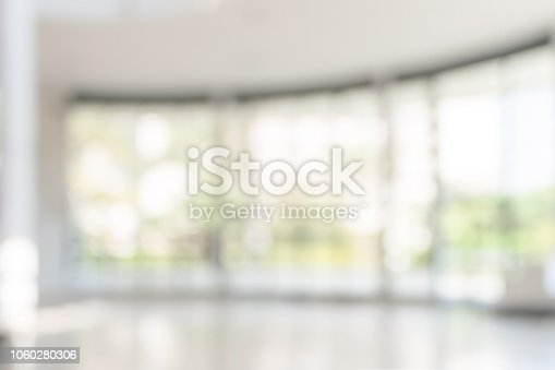 1009742300 istock photo Blur background interior view looking out toward to empty office lobby and entrance doors and glass curtain wall 1060280306