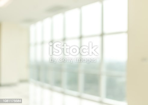 1009742300 istock photo Blur background interior view looking out toward to empty office lobby and entrance doors and glass curtain wall 1081175584