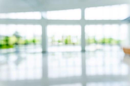 Blur background of empty lobby in hospital.