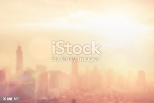 Blur background of morning light on sky with bokeh and sun flare at Bangkok city night life