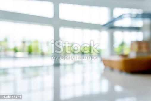 Blur background of reception desk on hospital lobby.