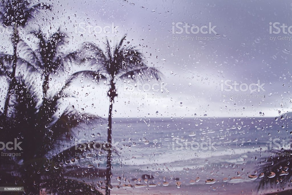 Blur background tropical island storm rain on window stock photo