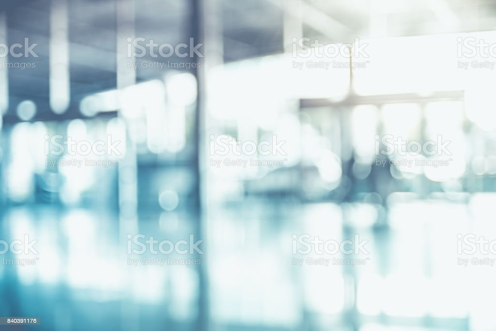 Blur background,businessman walking at corridor in convention hall, office building hall way background stock photo
