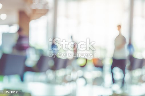 istock Blur background,businessman walking at corridor in hall 612230298