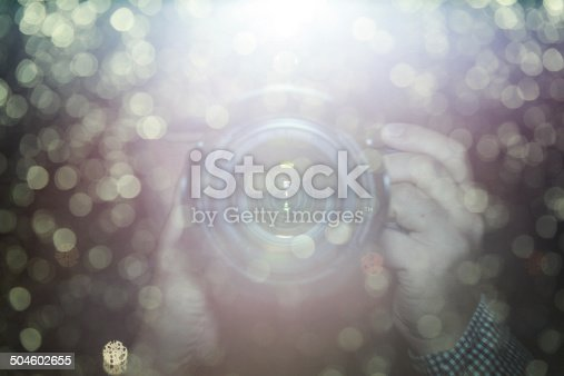 istock blur background,Reflection of hand holding camera 504602655