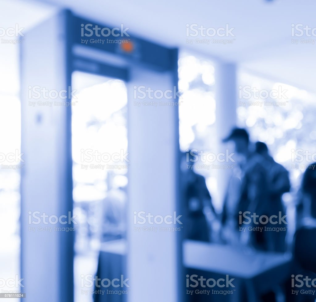 blur blue weapon  inspection machine door and  policemen stock photo